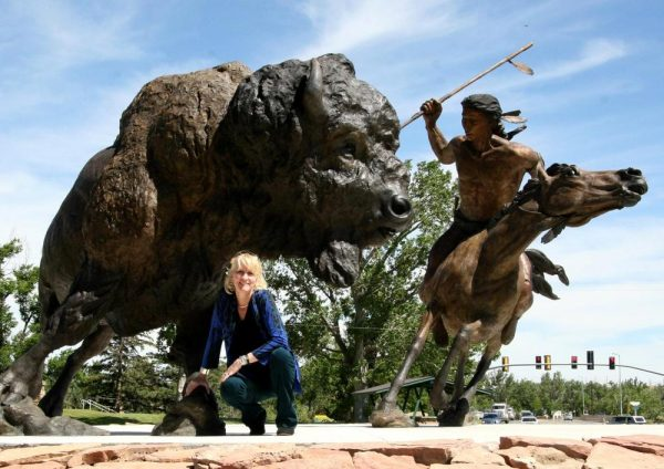 Gods Sacred Gift - Bison and Hunter Monument Gods Sacred Gift - Monument Monuments Life-size sculpture