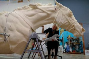 Jocelyn Russell used the maquette sculpture she created as a guide for carving details into the enlarged foam version of the Secretariat monument. Karl W. Schmidt