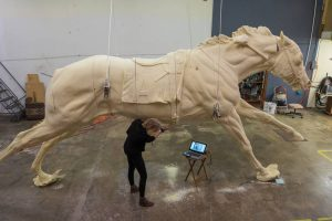Jocelyn Russell carved details into the foam version of the Secretariat monument. The bronze monument will stand 11 feet tall and stretch out to 21 feet.KARL W. SCHMIDT