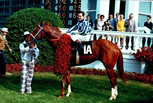 Secretariat and jockey Ron Turcotte posed in the winner's circle after the 1973 Kentucky Derby at Churchill Downs in Louisville. Holding on at left was groom Ed Sweet. AP